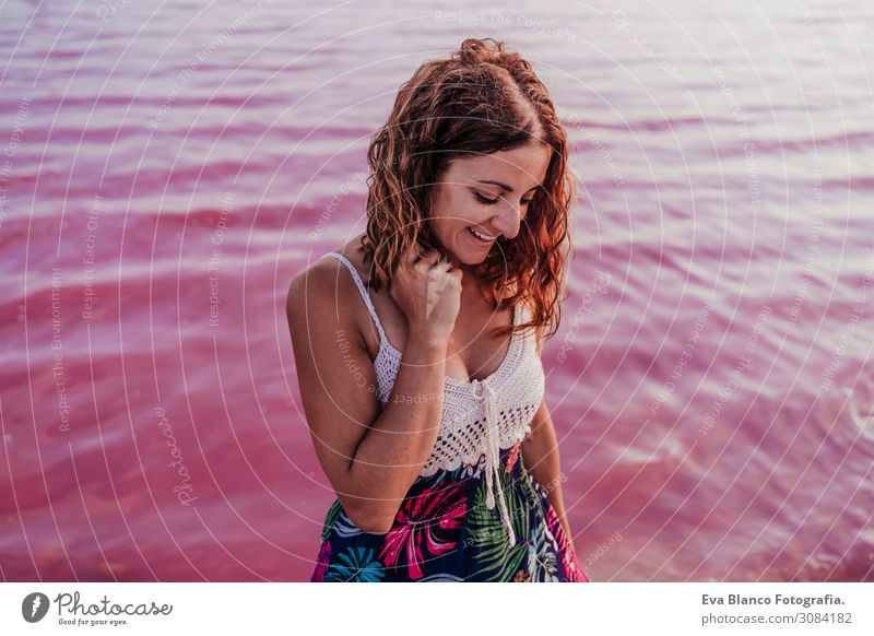 portrait of young beautiful woman by a pink water lake Lifestyle Happy Beautiful Relaxation Leisure and hobbies Vacation & Travel Tourism Summer Beach Ocean