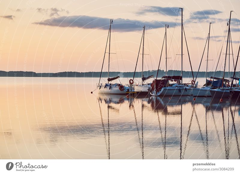 Yachts and boats moored in a harbour Relaxation Leisure and hobbies Vacation & Travel Tourism Cruise Summer Ocean Nature Coast Lake Harbour Sailboat Watercraft