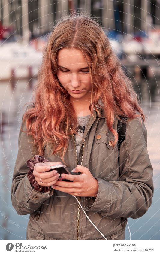 Young woman using mobile phone smartphone Lifestyle Vacation & Travel Summer Telephone Cellphone PDA Technology Internet Human being Youth (Young adults) Woman