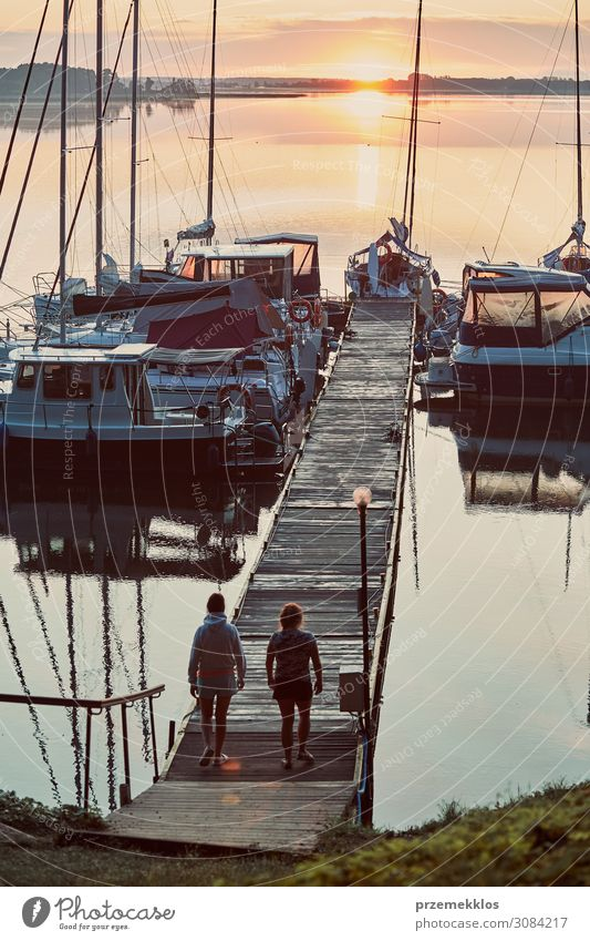Yachts and boats moored in a harbour Human being Vacation & Travel Nature Youth (Young adults) Young woman Summer Beautiful Ocean Relaxation Adults Coast