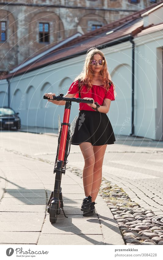 Girl using electric scooter Lifestyle Relaxation Leisure and hobbies Summer Technology Human being Young woman Youth (Young adults) Woman Adults 1 13 - 18 years
