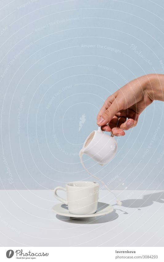 Woman's hand pouring almond milk into cup of coffee White Hand Lifestyle Table Coffee Beverage Breakfast Hot Tea Cup Aromatic Tasty Mug Caffeine Saucer
