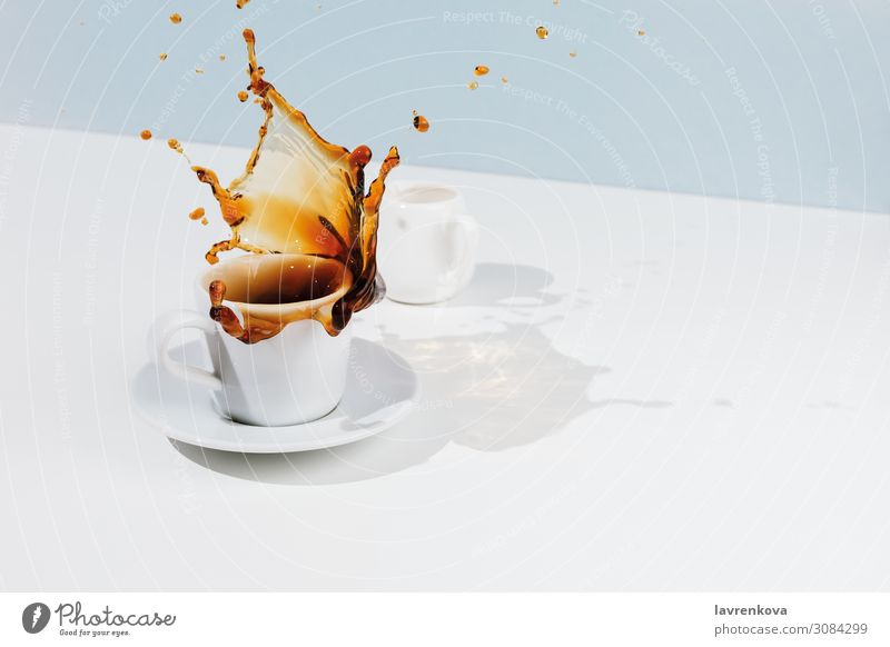 Closeup of cup with splashing coffee, saucer and creamer Saucer Pastel tone Blue Movement Tea Food Food photograph Coffee Breakfast Black Drop Cup Beverage