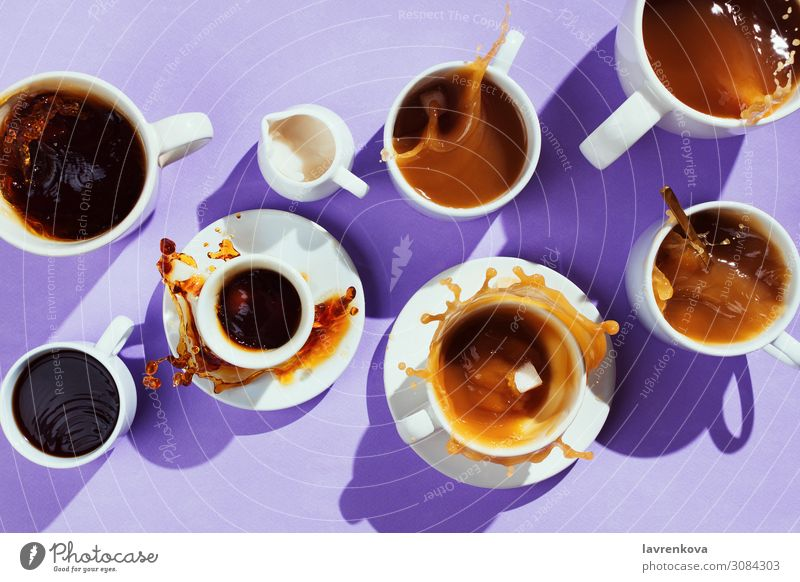 various cups with coffee and creamer on purple Cup Mug dishware Sweet Spoon Cappuccino Sugar latte flatlay Espresso Black Hot Splashing Beverage Tasty Dessert