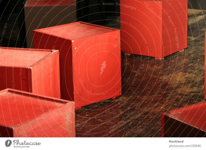Stage construction 2 Thrown down Concert Music red cubes Wooden board in the spotlight retired boards
