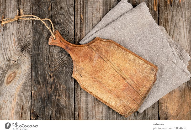 empty old brown wooden cutting board with handle Design Kitchen Wood Old Dirty Dark Natural Above Retro Brown Gray Ancient background Blank chopping cooking