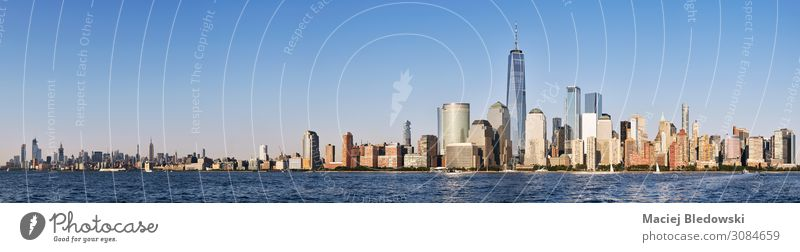 New York City skyline with cloudless sky. Shopping Luxury Vacation & Travel City trip Summer Living or residing Office Sky Beautiful weather River Downtown