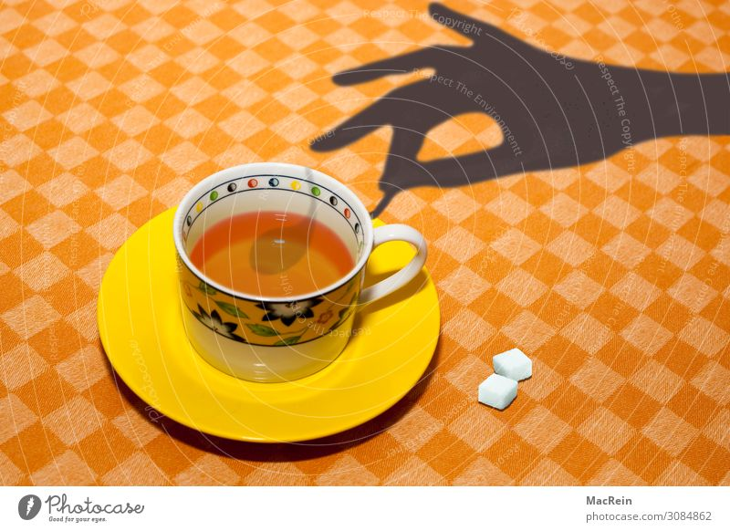teacup Breakfast Hot drink Tea Cup Spoon Hand Drinking Sugar Plate Stir Tablecloth Shadow Colour photo Interior shot