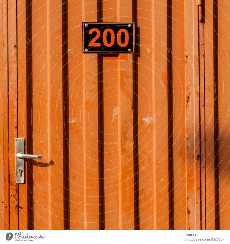200 Construction site Door Site trailer Metal Digits and numbers Signs and labeling Orange Black Arrangement Colour photo Exterior shot Deserted
