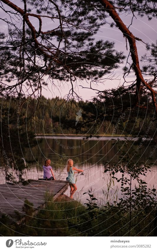 Girls fishing in the evening light Harmonious Relaxation Calm Leisure and hobbies Playing Fishing (Angle) Vacation & Travel Tourism Adventure Summer Island