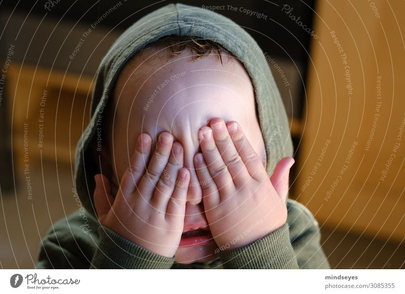 Little boy with hood closes his eyes. Children's game Hide Masculine Toddler Family & Relations Infancy Face 1 - 3 years Touch To hold on Playing Brash