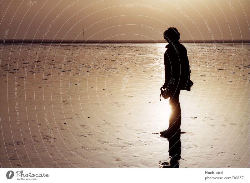 Woman in the Watt Husum St. Peter-Ording Back-light Walk along the tideland Infinity Mud flats North Sea Sun Shadow Far-off places
