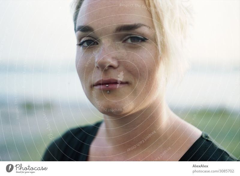 Portrait of a young woman with freckles Lifestyle Style Joy Beautiful Contentment Young woman Youth (Young adults) Freckles 18 - 30 years Adults Landscape