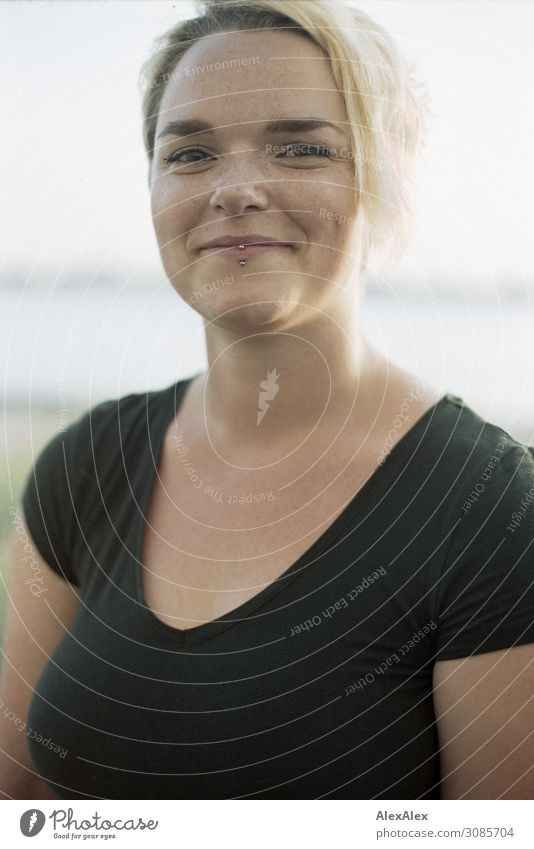 Portrait of a smiling young woman in black top in front of the river Elbe Lifestyle Joy pretty Well-being Young woman Youth (Young adults) pit 18 - 30 years