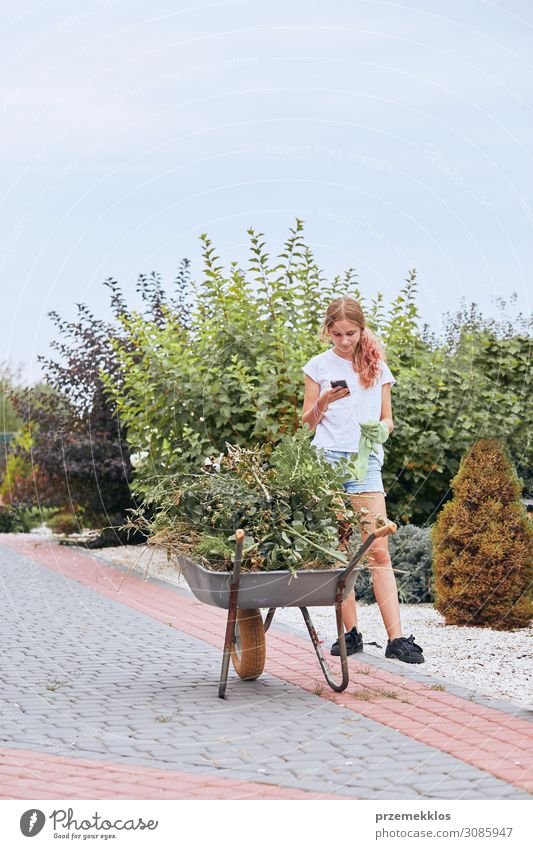 Teenage girl working at a home garden Woman Human being Youth (Young adults) Young woman Summer Plant Green Flower Lifestyle Adults Happy Garden Together