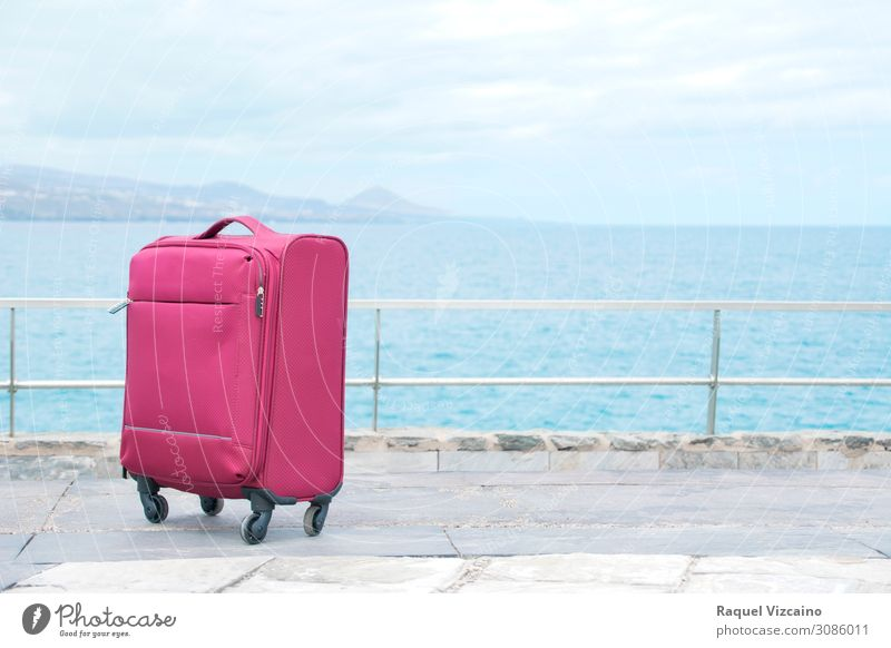 Red travel suitcase Lifestyle Vacation & Travel Tourism Trip Sightseeing Ocean Horizon Suitcase To enjoy Blue White Adventure Discover Far-off places Target