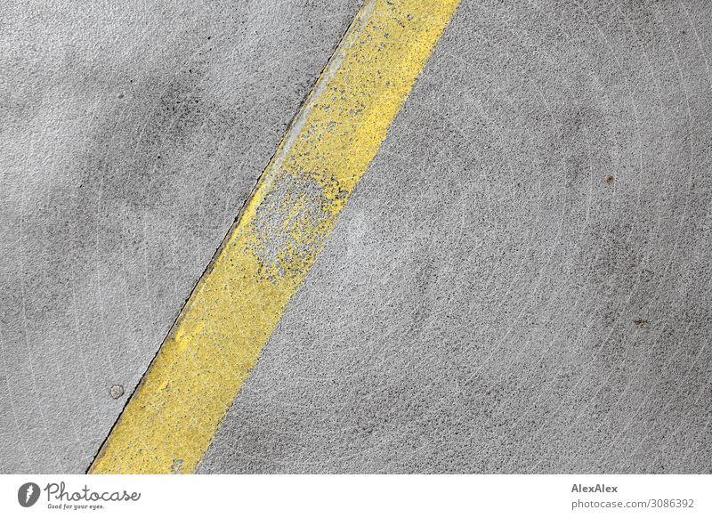 Yellow strip road marking on concrete Incomplete Old Concrete Ground concrete road Street Lane markings pores Crumbled Broken Diagonal Pattern