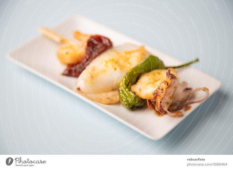 typical Spanish tapa Dinner Diet Plate Ocean Table Restaurant Fresh White Tasty Squid fish mediterranean food chef cook BBQ cuttlefish Snack market flavor
