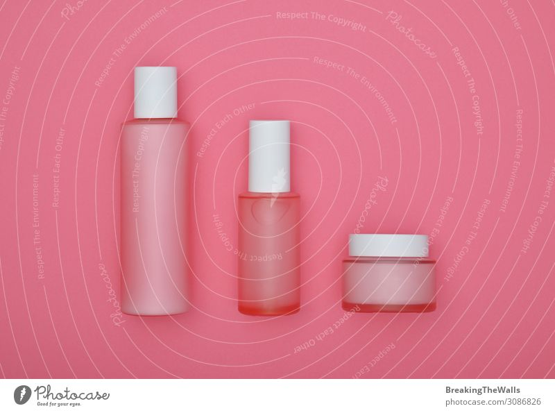 Set of beauty cream bottles over pink background Beautiful White Healthy Face Health care Hair and hairstyles Pink Body Glass Skin Personal hygiene Cosmetics