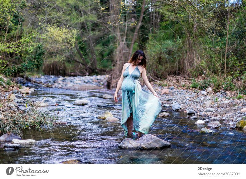 Pregnant girl posing near the river wearing a green dress. Lifestyle Style Joy Happy Beautiful Relaxation Freedom Summer Ocean Human being Feminine Young woman