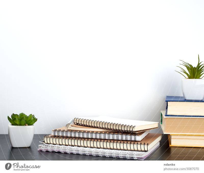 stack of spiral notebooks with white pages Pot Design House (Residential Structure) Decoration Table School Work and employment Workplace Office Business Plant
