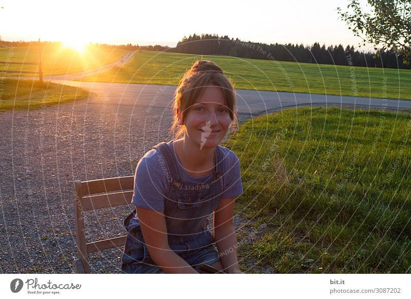 Young woman against the light Feminine Girl Youth (Young adults) Joy Happy Happiness Contentment Joie de vivre (Vitality) Dusk Looking Looking into the camera