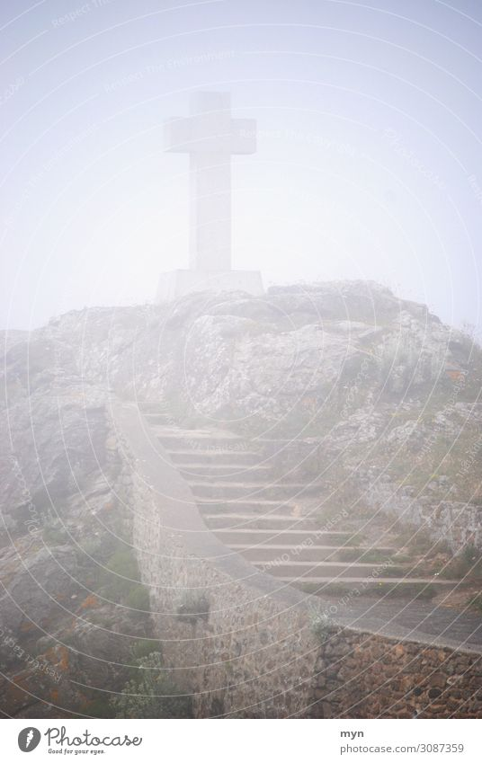 Celtic or Christian cross in the fog on a hill with stairs by the sea Crucifix Fog Stairs Grief Death Christianity Religion and faith Belief Shroud of fog