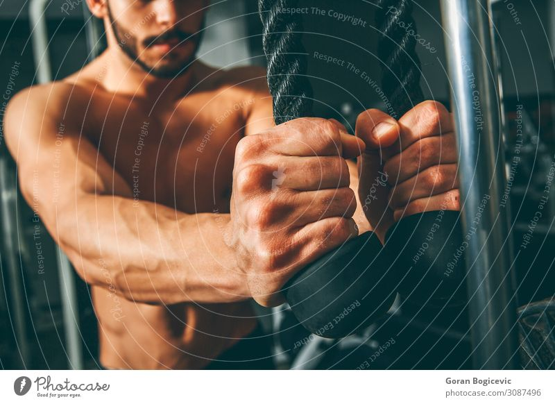 Muscular man working out in gym Lifestyle Body Sports Fitness Sports Training Sportsperson Rope Human being Masculine Young man Youth (Young adults) Man Adults