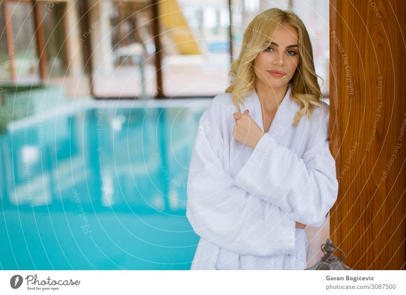 Beautiful young blonde woman relaxing at indoor swimming pool Lifestyle Style Wellness Relaxation Spa Swimming pool Leisure and hobbies Human being Feminine