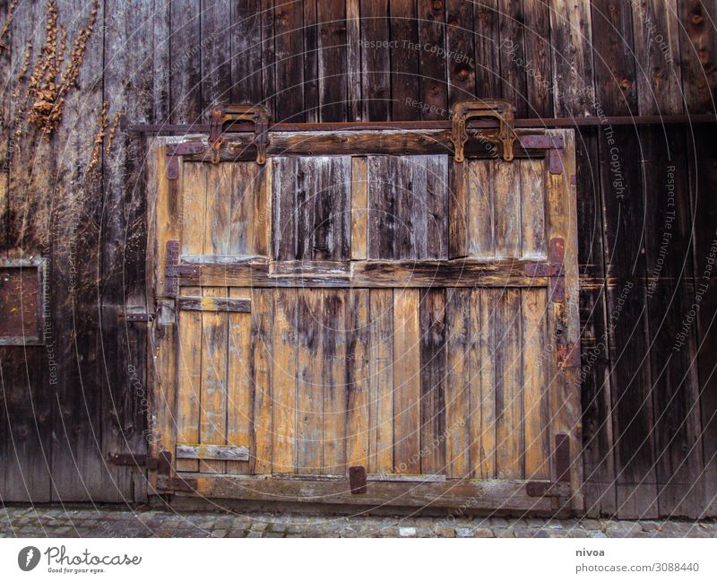 Old wooden gate Mountain Machinery Hut Barn Barn door Door Gate Vehicle Wood Utilize Discover Faded Authentic Dark Sustainability Brown Emotions Safety