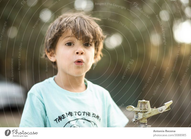 wow kid Happy Summer Garden Child Human being Boy (child) Infancy Autumn Kissing Smiling three years old sprinkler Caucasian real people cnadid whistling 3s