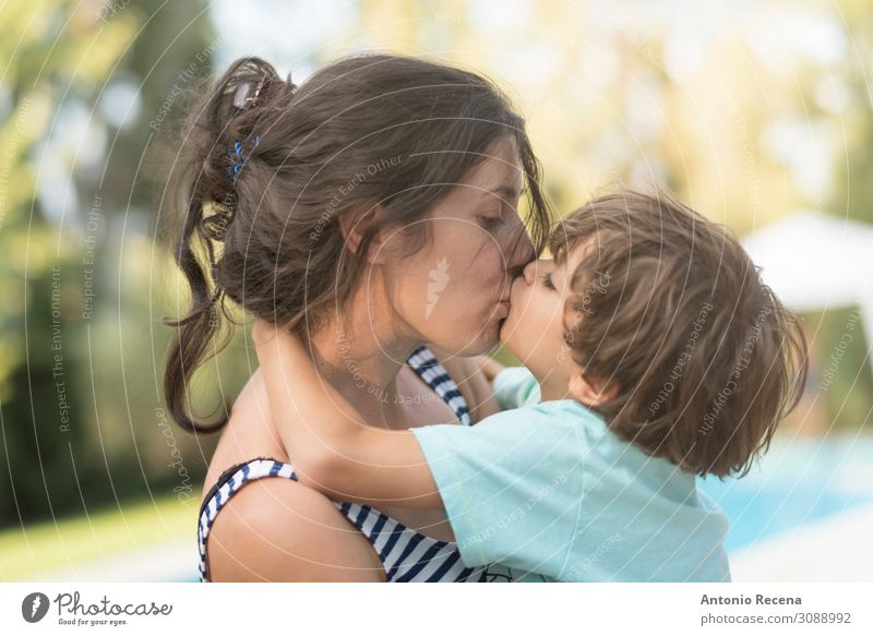 Mother kissing son in garden outdoors images Woman Child Human being Lifestyle Adults Love Family & Relations Happy Boy (child) Garden Infancy Kissing Parents