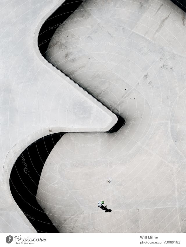 Person Standing in the Middle of a Skate Park from Above Drone Skate park Aircraft Skateboarding Inline skating Board Shadow Structures and shapes Minimal