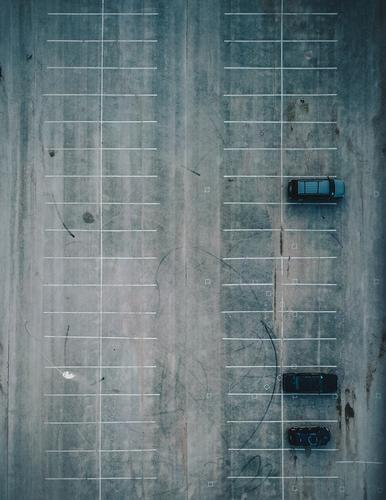 Three Cars in a Parking Lot Drone Aircraft Motor vehicle 3 Empty Minimal Line Parked lot Parking lot Structures and shapes Symmetry