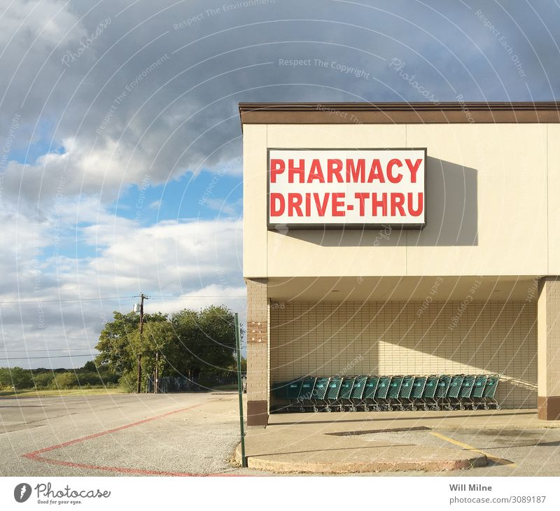 Pharmacy Storefront in a Small Town Storage Medication Drugstore Cart Shopping Trolley Food drive through Old Front view Front side Signage