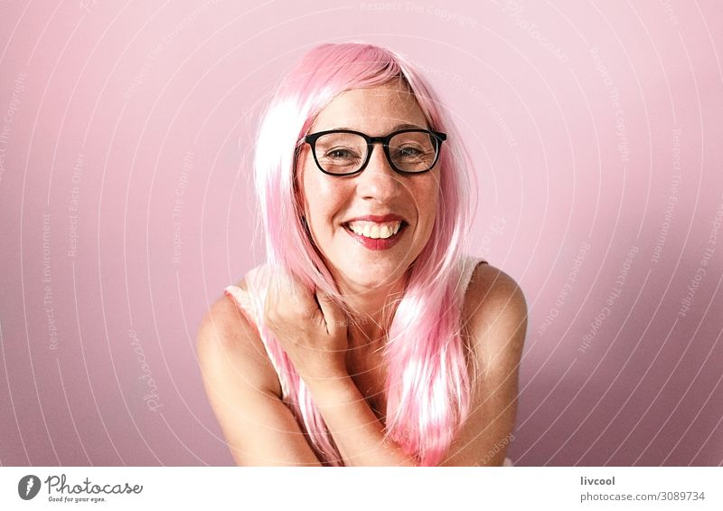 woman with pink wig smiling happily on pink background Lifestyle Happy Human being Feminine Woman Adults Female senior Head Hair and hairstyles Face Eyes Nose