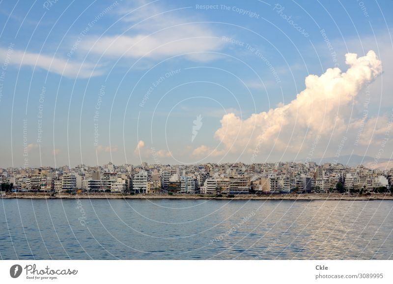 Sky Vacation & Travel Summer Blue Town Water White Ocean House (Residential Structure) Clouds Environment Coast Moody Flat (apartment) Gold Air