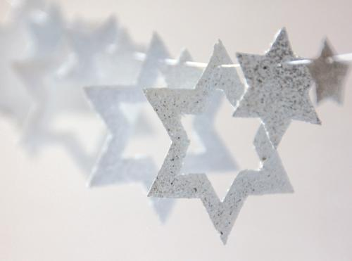 white stars in different sizes hang on a string as decoration Christmas & Advent Decoration Star (Symbol) Chain Sign To hold on Hang Esthetic Exceptional