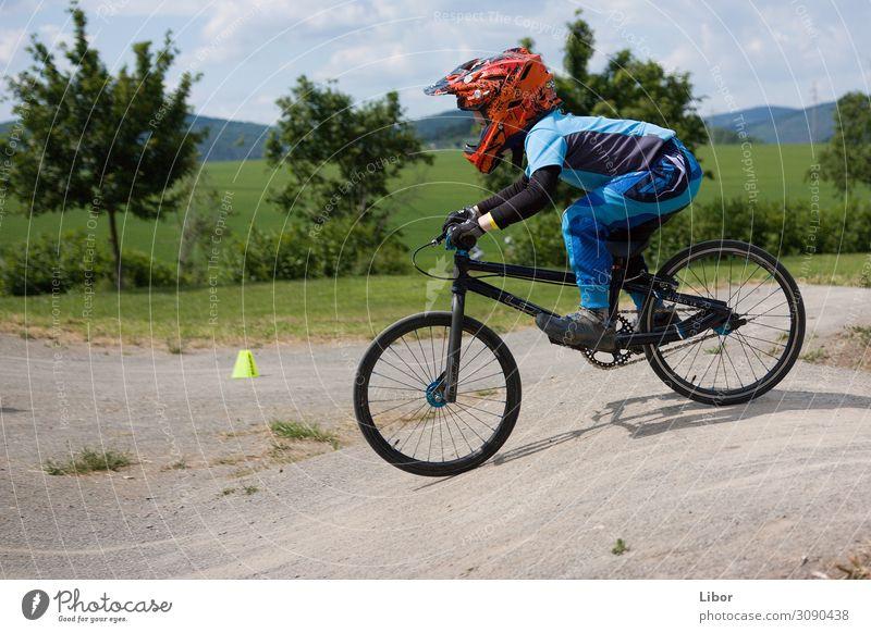 Boy riding on is bike Child Human being Sports Boy (child) Jump Cycling Athletic Make BMX bike