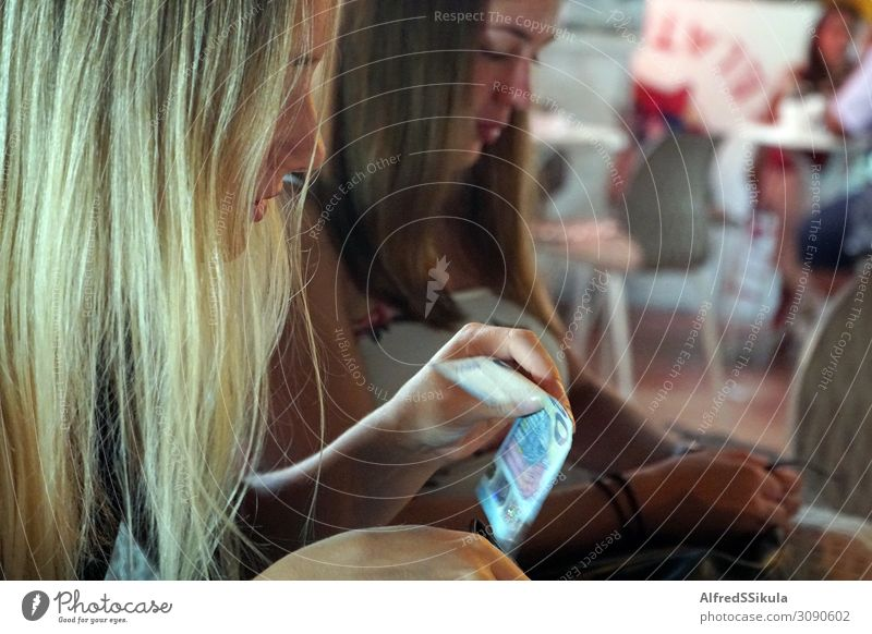 Two teenage girls sitting in a restaurant Human being Youth (Young adults) Young woman Blue Beautiful White Hand Black Face Feminine Brown Friendship