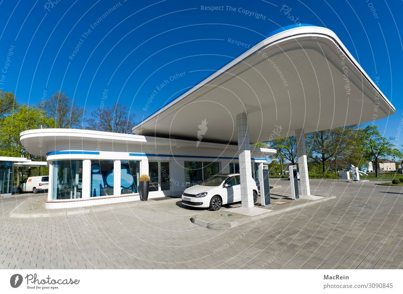 Retro petrol station Architecture Blue White Petrol station Petrol pump electric car e-car electric filling station Modern Copy Space Colour photo Exterior shot
