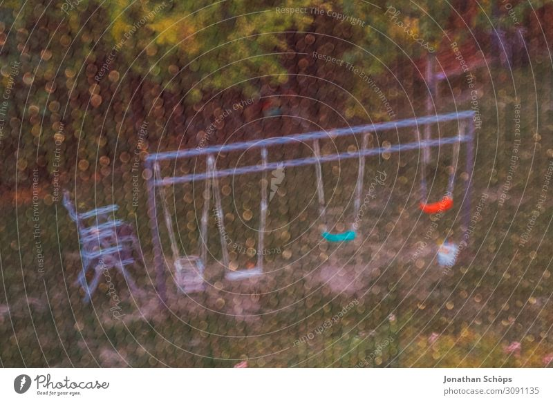 View of a garden with swings through a fly screen Autumn Multicoloured Garden Grating Exterior shot Playground screen door Swing Looking Window Fly screen