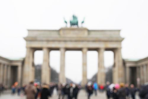 Tourists defocused in front of Brandenburg Gate Lifestyle Leisure and hobbies Vacation & Travel Tourism Sightseeing City trip Human being Adults Group