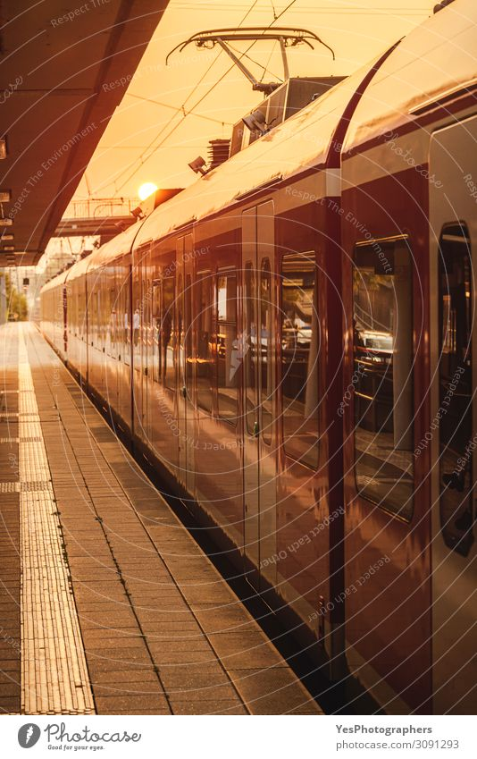 Passengers train in station at golden hour. Vacation & Travel Trip Train station Transport Means of transport Passenger traffic Public transit Train travel