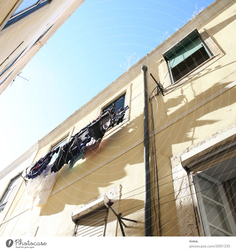 washed Sky Beautiful weather Lisbon House (Residential Structure) Wall (barrier) Wall (building) Facade Window Roof Eaves Clothesline Laundry Washing