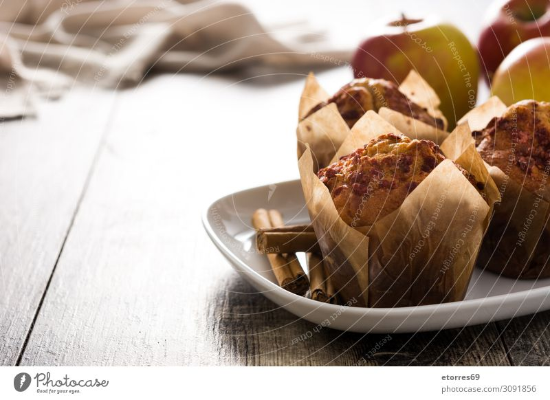 Apples and cinnamon muffins on wooden table. Muffin Cinnamon Baked goods Cake Baking Food Healthy Eating Food photograph Forest Wood Fruit White Brown Home-made