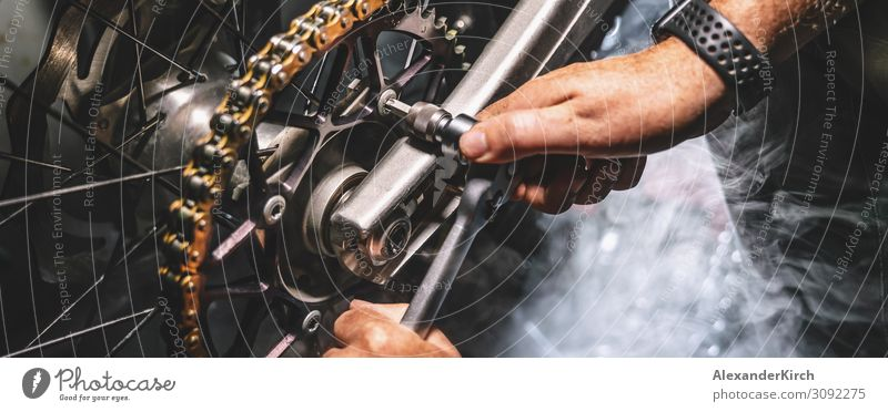 Mechanic working in garage. Repair service. Adult Education Profession Hand Car Motorcycle Movement bike mechanical automotive vehicle Store premises technician