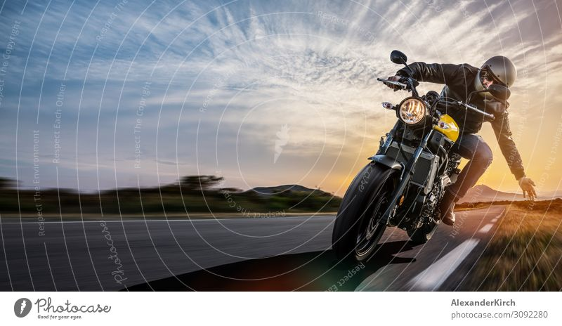 man on a motorbike on the road riding. Lifestyle Joy Vacation & Travel Sports Engines Human being Motorcycle Utilize Power motorcyclist rider race Sunset