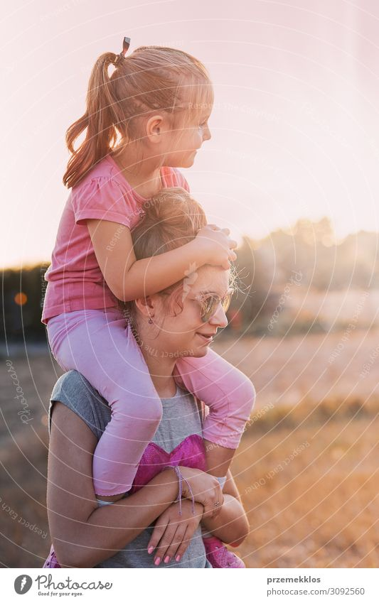 Sisters enjoying piggyback ride Woman Child Human being Vacation & Travel Nature Youth (Young adults) Young woman Summer Blue Landscape Sun Relaxation Joy Girl