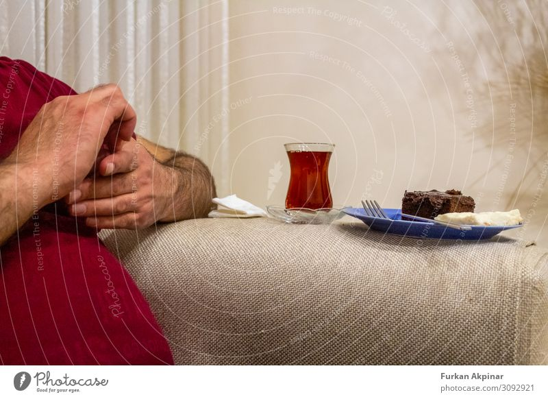 Belly man sitting his hand, next to him have tea and cake Human being Man Hand Healthy Adults Arm Fingers Stomach 30 - 45 years